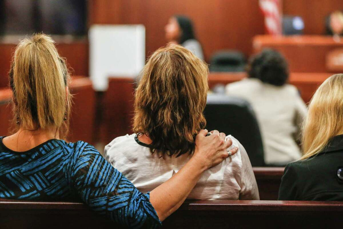 The family of Michelle Warner listens to opening arguments during the trial of Mark Augustin Castellano, who is accused of murdering his girlfriend, Michelle Warner.