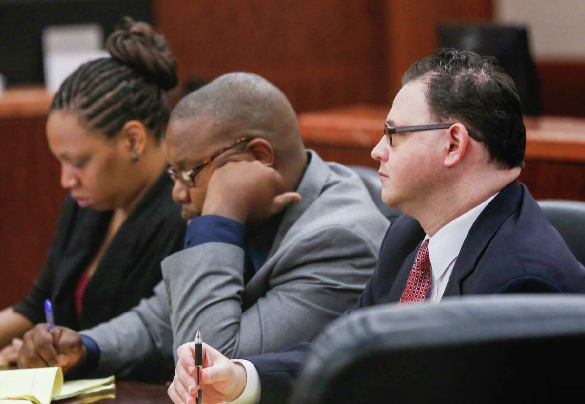 Mark Augustin Castellano, right, next to his attorneys during opening arguments.he is accused of murdering his girlfriend, Michelle Warner, Tuesday, May 27, 2014.