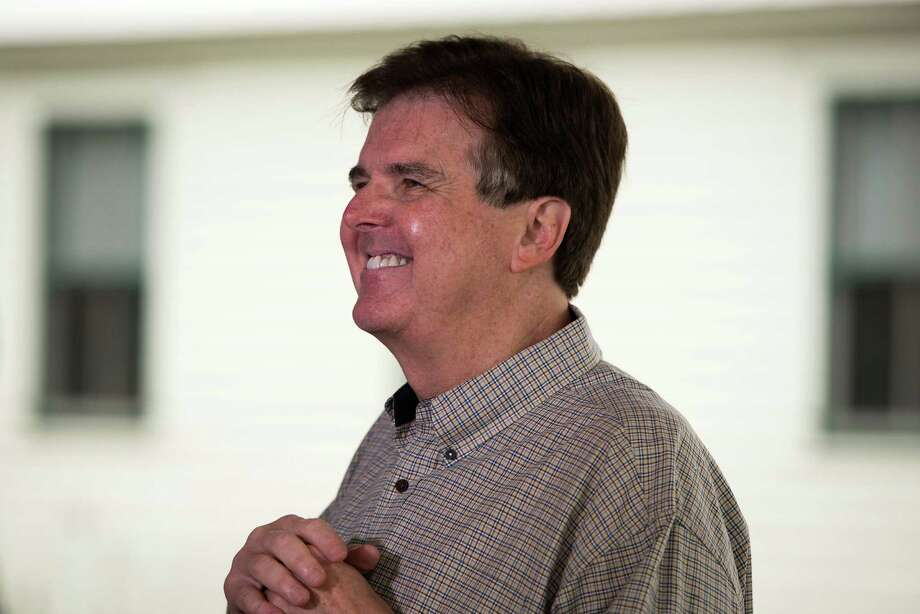 State Sen. Dan Patrick smiles as he addresses the media outside a polling place at Cypress Top Park. Photo: Smiley N. Pool, Houston Chronicle / © 2014  Houston Chronicle
