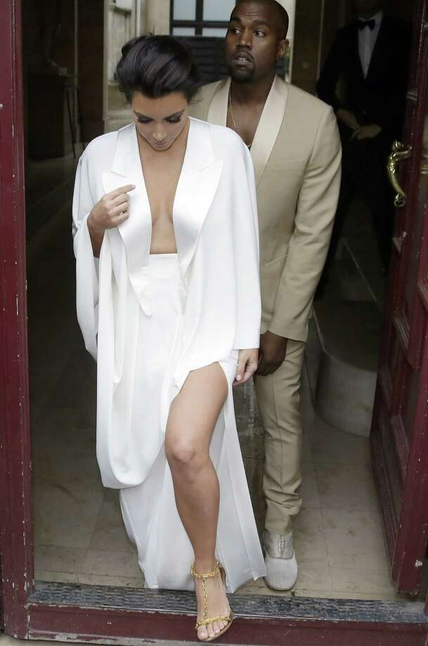 "Kim Kardashian and Kanye West tied the knot over Memorial Day weekend in Florence, Italy. Being a musician himself, you know the music Kanye helped pick out for the matrimonial festivities was going to be good... even if it meant taking a hands-on approach. The first dance song? A mashup of 'At Last,' followed by 'These Arms of Mine,' and 'Tenderness.' But wait, there's more: the groom even busted out with a rap during the first dance.What's more, John Legend was on hand to sing his hit song 'All of Me' during the reception.Take a look at other celebrity power couples and the songs they got down to after saying ""I do."" Photo: KENZO TRIBOUILLARD, AFP/Getty Images / AFP"