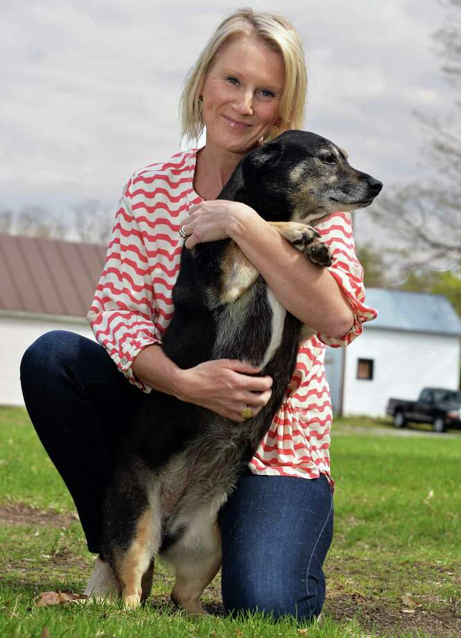 Photographers Without Borders volunteer Tracey Buyce with Roxy outside her home Saturday May 3, 2014, in Saratoga Springs.  (John Carl D'Annibale / Times Union) Photo: John Carl D'Annibale / 00026682A