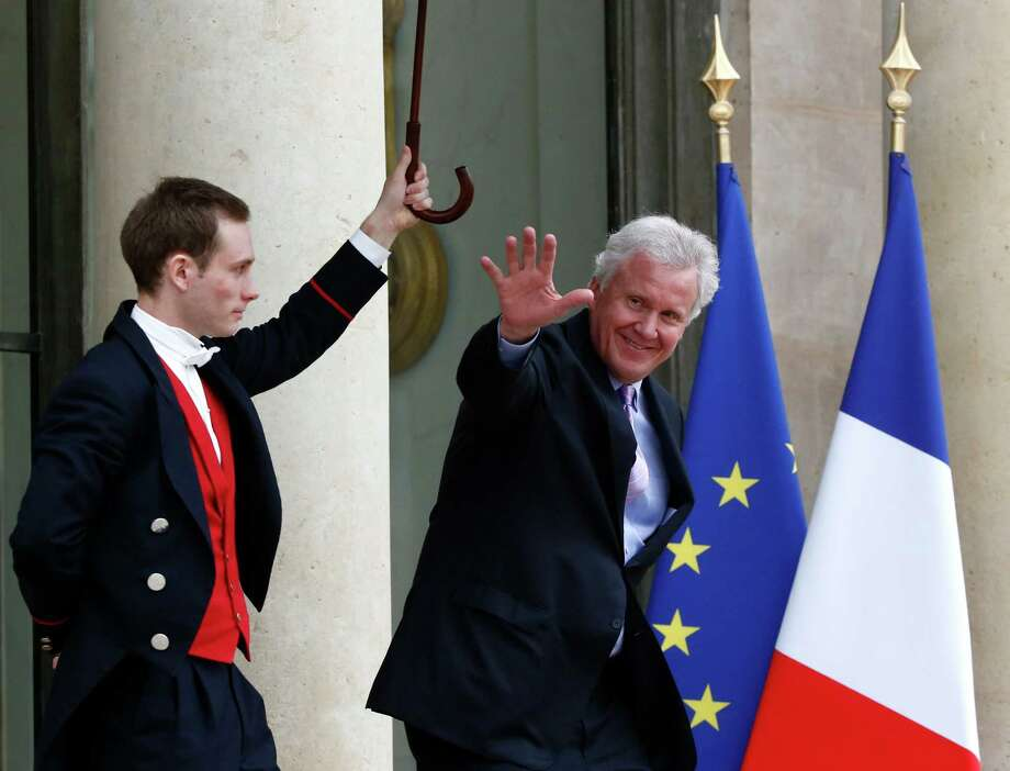 General Electric CEO Jeffrey R. Immelt leaves the Elysee Palace after meeting with French President Francois Hollande in Paris, Monday, April 28, 2014. Immelt is set to appear before the French parliament on Tuesday to defend the company's $16.9 billion big for Alstom's energy unit. (AP Photo/Michel Euler) Photo: Michel Euler, Associated Press / Associated Press contributed