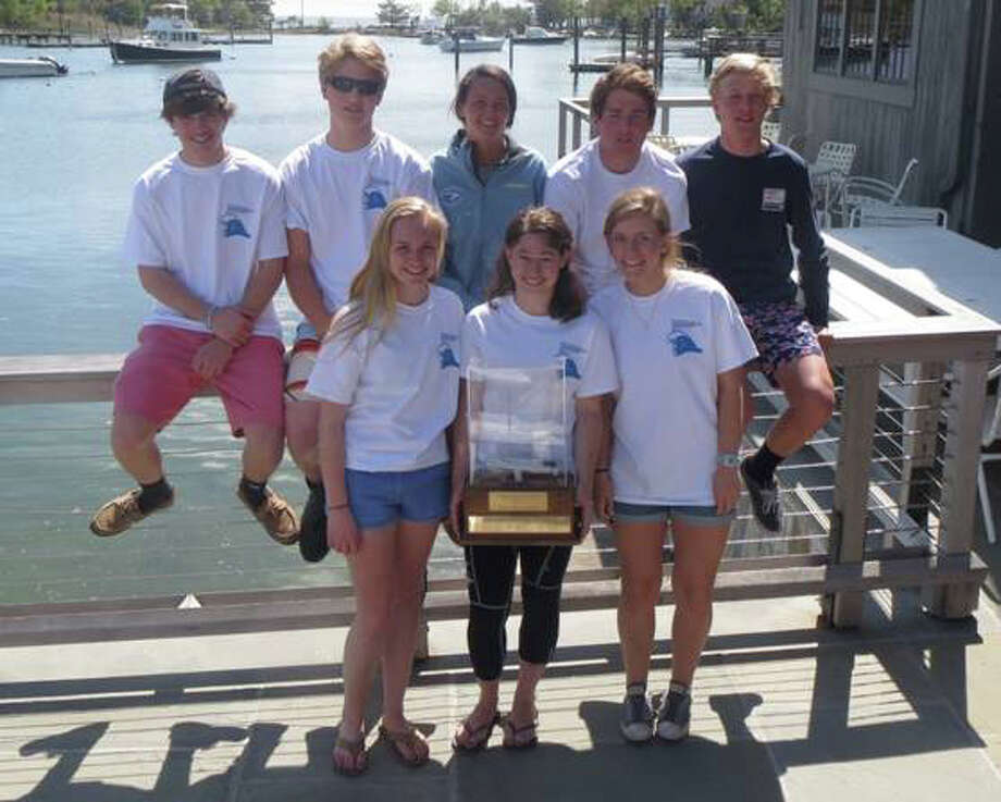 The Darien High School sailing team poses with the Gold Cup after winning the 2014 Fairfield County Sailing League Championship. From left to right in the top row are Chris Graves, Chris Milne, Emma Janson, Owen Beringer, Flo Eenkema Van Dijk. From left to right on the botom stand Taylor Hart, captain Haley Okun and Megan Berry. Photo: Contributed / Darien News Contributed