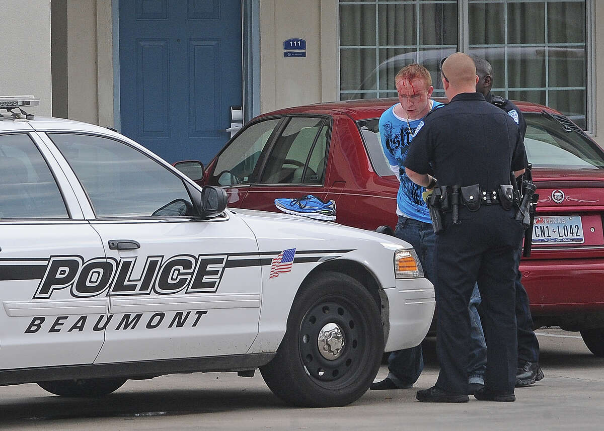 2. BEAUMONTAbove:Beaumont Police arrest a man in connection with a meth lab bust at the Howard Johnson on Interstate 10. Two other people were taken into custody. (Guiseppe Barranco/The Enterprise)