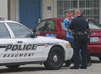 Beaumont Police arrest a man in connection with a meth lab bust on Wednesday at the Howard Johnson on Interstate 10. Two other people were taken into custody by Police who received a Crime Stoppers tip hours before the arrests were made. Guiseppe Barranco/The Enterprise