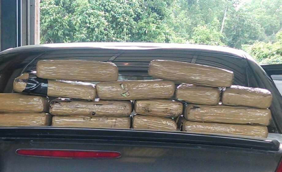 May 7, 2014:Officials found 24.56 pounds (11.16 kilos) of cocaine concealed in a homemade compartment inside a vehicle frame. The cocaine has a value of about $334,800, and Jeanie Burciaga, 38, and Adrian Martinez, 38, of Brownsville, were arrested and booked into the Fort Bend County Jail on charges of manufacturing/delivery of a controlled substance and second degree charges of unlawful use of a criminal instrument.  Photo: Fort Bend County