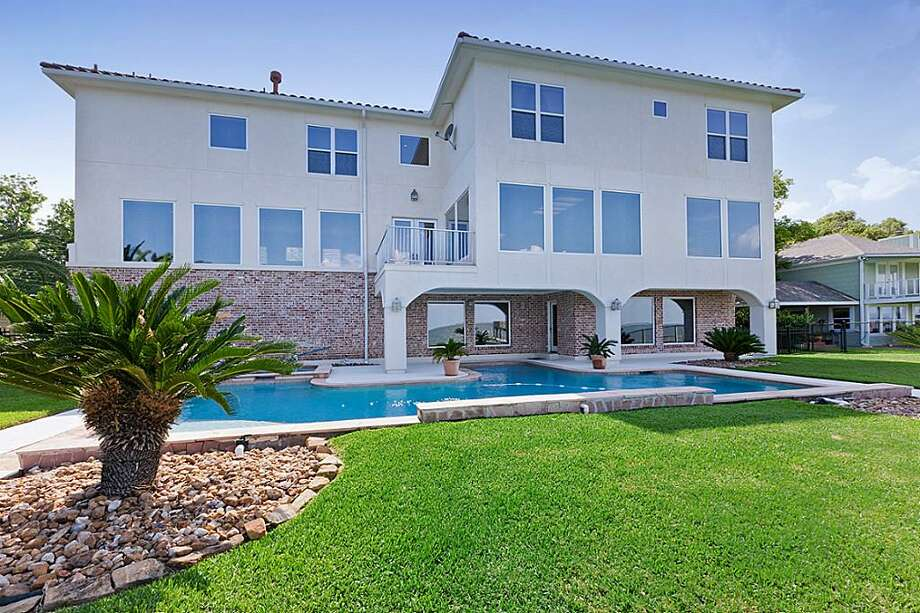 2427 Crescent Drive in La Porte: Although La Porte came in at No. 7 on the most boring cities in Texas list, this 2004 Mediterranean-style La Porte villa is anything but dull. The cool property has a backyard pool, hot tub, fishing and boating dock, 4-6 bedrooms, 4.5 bathrooms, and 5,133 square feet. Listed for $965,000. Photo: Houston Association Of Realtors