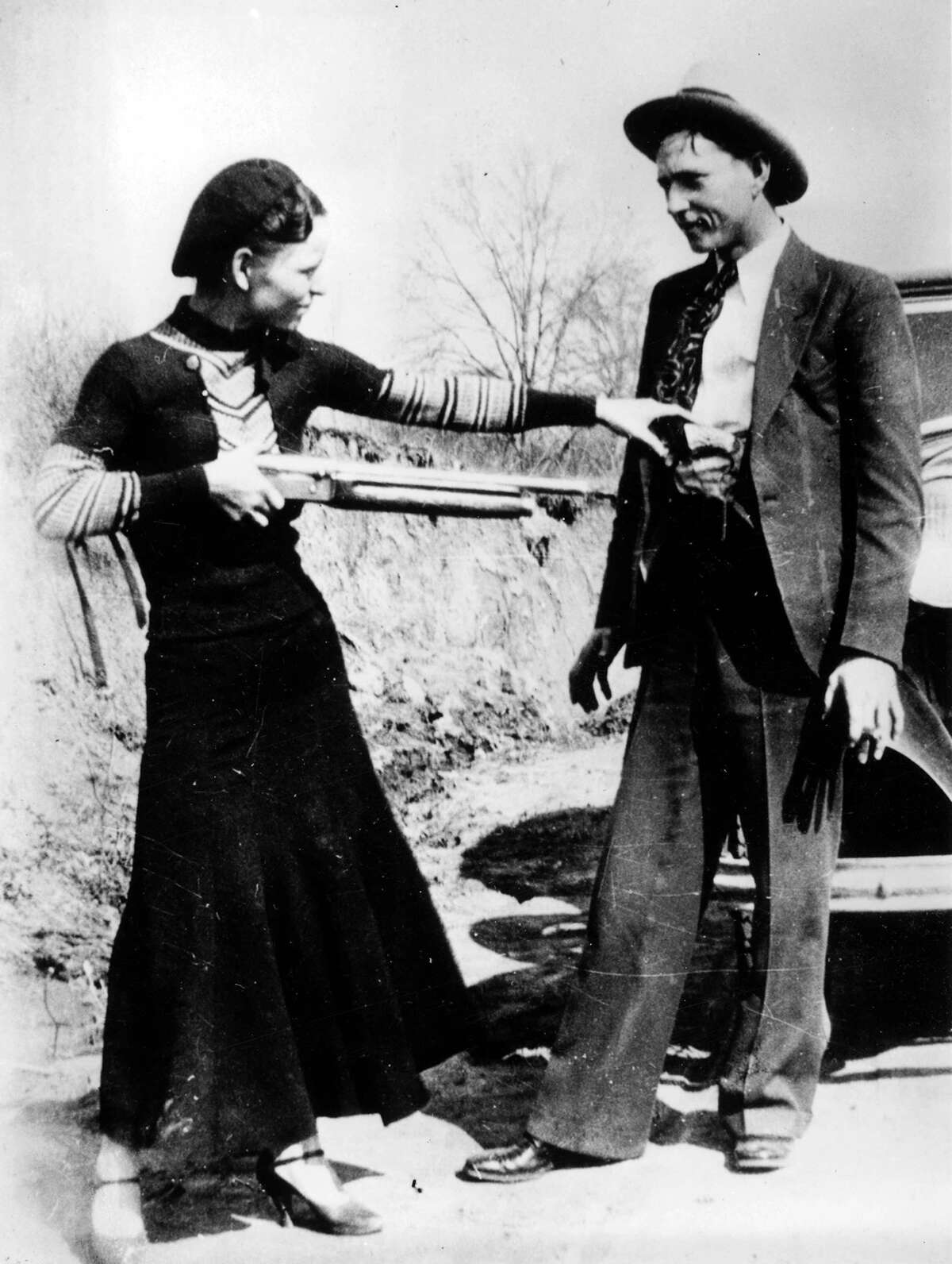 Infamous outlaws Bonnie Parker and Clyde Barrow are suspected of killing at least nine police officers and robbing ten banks and many more rural stores and gas stations before being gunned down by Texas and Louisiana police officers in 1934.