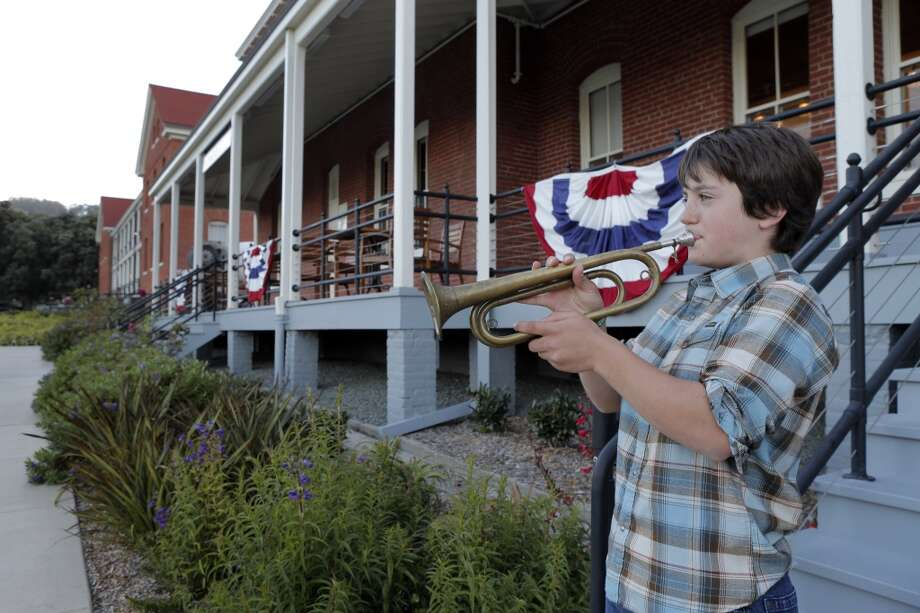 Eliot Singer, 11, plays a military bugle outside Traci Des Jardins' newest restaurant, The Commissary. Photo: Carlos Avila Gonzalez, The Chronicle