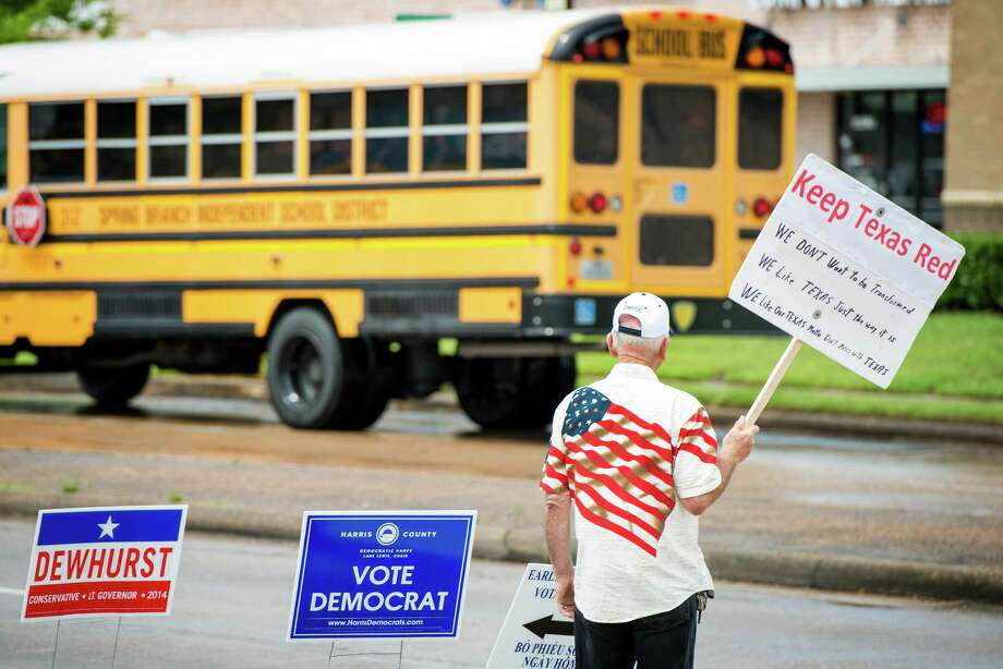 Bob Hall holds a sign in support of Republican candidates outside a polling place at the Trini Mendenhall Community Center in Houston.  Photo: Smiley N. Pool, Houston Chronicle / © 2014  Houston Chronicle