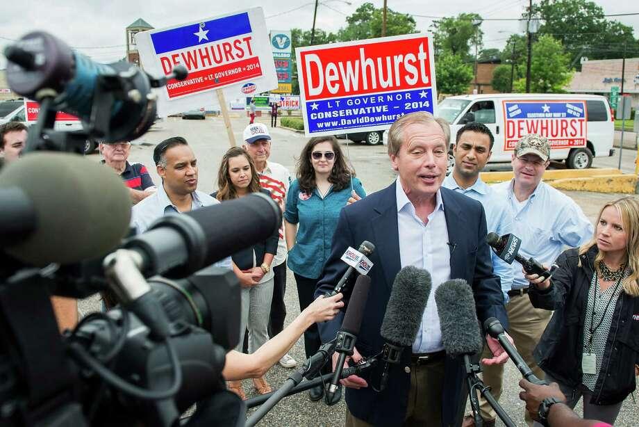 Lt. Gov. David Dewhurst addresses the media outside a polling place. Photo: Smiley N. Pool, Houston Chronicle / © 2014  Houston Chronicle