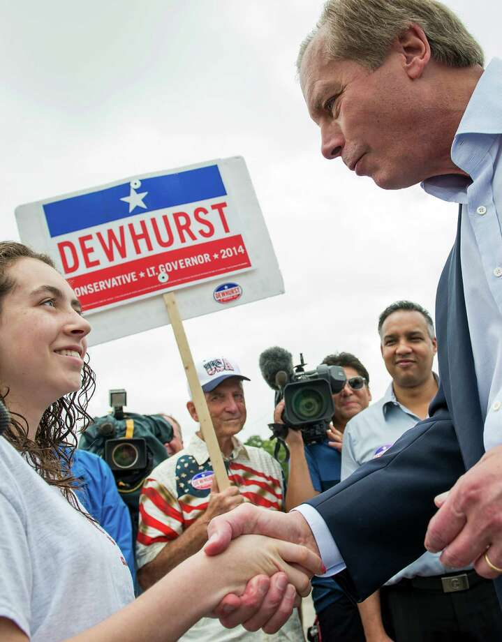 Lt. Gov. David Dewhurst shakes hands with Anna McCorkle, 14, outside a polling place in Houston.  Photo: Smiley N. Pool, Houston Chronicle / © 2014  Houston Chronicle
