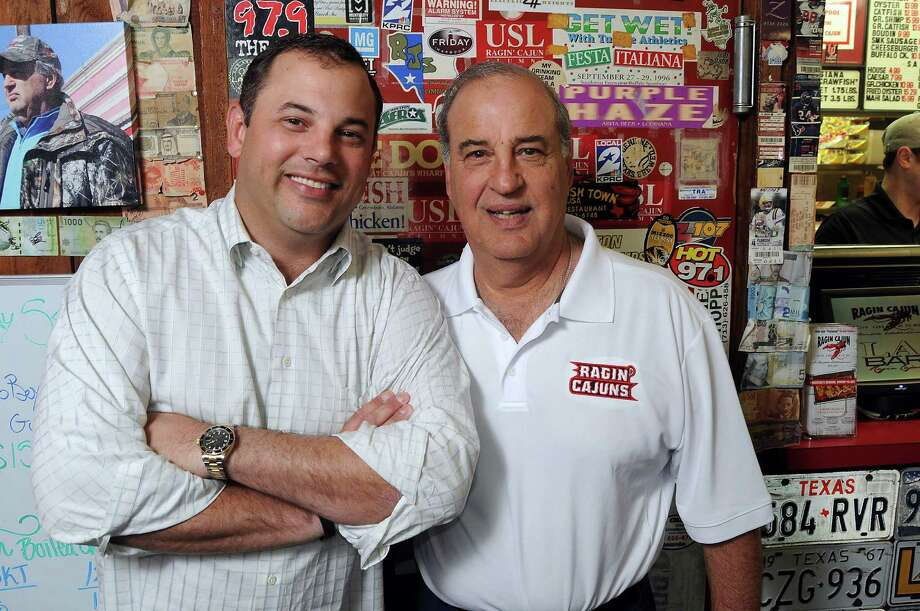 Founder Luke Mandola and his son Dominic at the original Ragin Cajun on Richmond. Photo: Dave Rossman, Freelance / © 2014 Dave Rossman