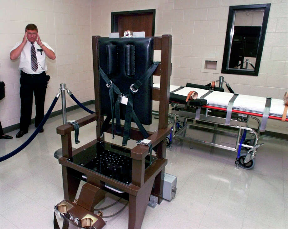 In this 1999 photo, Ricky Bell, then warden at Riverbend Maximum Security Institution in Nashville, Tennessee, gives a tour of the prison's execution chamber. Tennessee Gov. Bill Haslam signed a bill into law Thursday, May 22, 2014, allowing the state to electrocute death row inmates in the event prisons are unable to obtain lethal injection drugs, which have become more and more scarce following a European-led boycott of drug sales for executions. The state has used lethal injection since 1999, but has never stopped giving inmates the choice of dying in the electric chair. Click through the slideshow to see more photos of the electric chair throughout America's history.  Photo: Mark Humphrey, Getty Images / AP