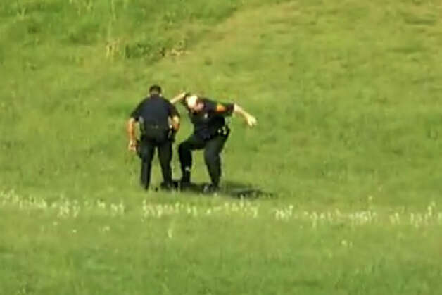 A screen grab from a video, posted on YouTube on Jan. 6, 2013, showing three Bridgeport, Conn. police officers kicking a man in Beardsley Park on May 20, 2011. On Tuesday, May 27, 2014 city officials said they agreed to settle the man's civil rights lawsuit against the Police Department, paying him $198,000. Photo: Contributed Photo / Connecticut Post Contributed