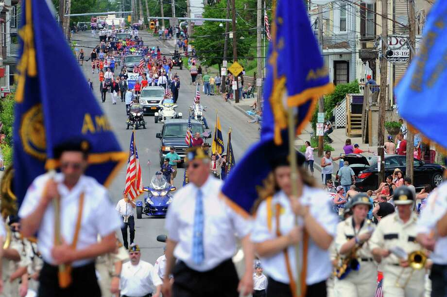 Veterans along with elected officials and community groups march along Broadway during the Rensselaer Memorial Day Parade on Sunday, May 25, 2014, in Rensselaer, N.Y.  (Paul Buckowski / Times Union) Photo: Paul Buckowski / 00027021A