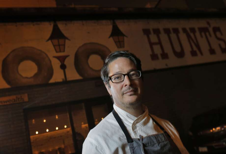 Chef Jason Fox outside his restaurant Commonwealth in San Francisco, Calif., on Wednesday, May 21, 2014. The sign on the wall is of an old shop at the location that was discovered when they remodeled the space. Photo: The Chronicle