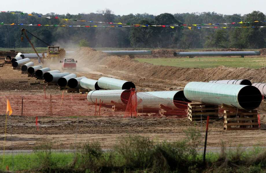 File - In this Oct. 4, 2012 file photo, large sections of pipe are shown in Sumner Texas. Safety regulators have quietly placed two extra conditions on construction of TransCanada Corp.'s Keystone XL oil pipeline after learning of potentially dangerous construction defects involving the pipeline's southern leg.  The new conditions were added four months after the pipeline safety agency sent TransCanada two warning letters about defects and other construction problems on the Keystone Gulf Coast Pipeline, which extends from Oklahoma to the Texas Gulf Coast. (AP Photo/Tony Gutierrez, file) Photo: Tony Gutierrez, STF / AP