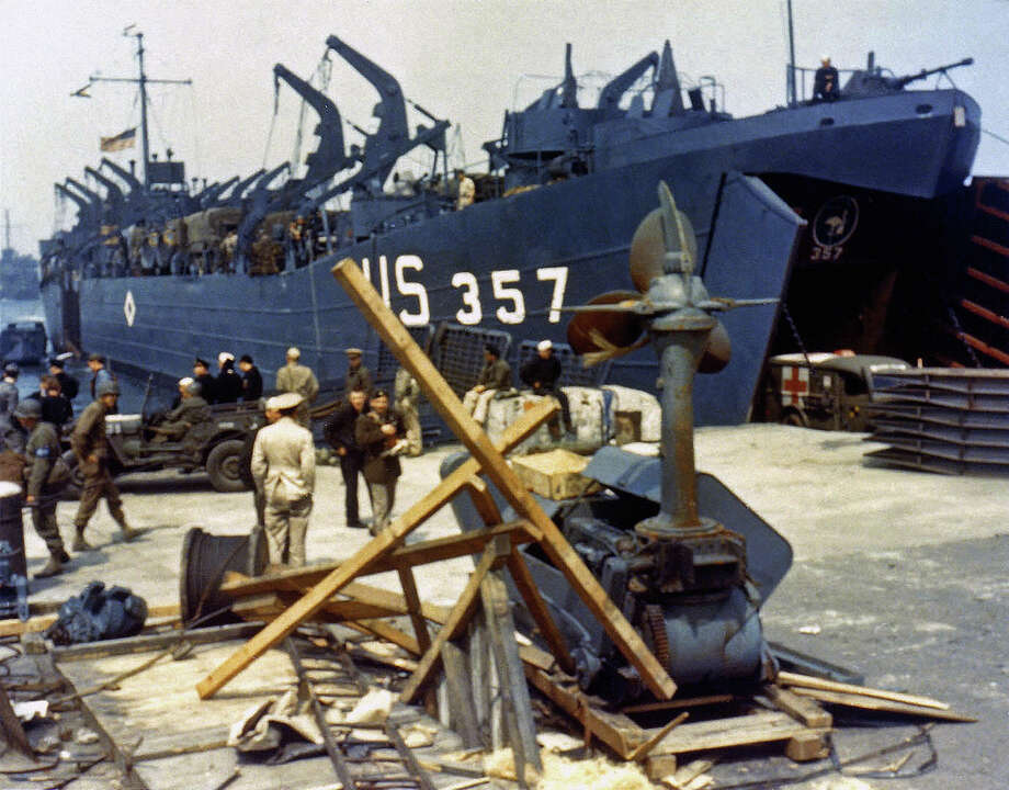 Landing Ship Tank (LST-357)  loading an ambulance at Portland Harbour, Dorset, before the D-Day landings, 5th June 1944. It will soon depart to participate in the cross channel invasion of Omaha Beach in Normandy. Photo: Galerie Bilderwelt, Getty Images / 2013 Galerie Bilderwelt