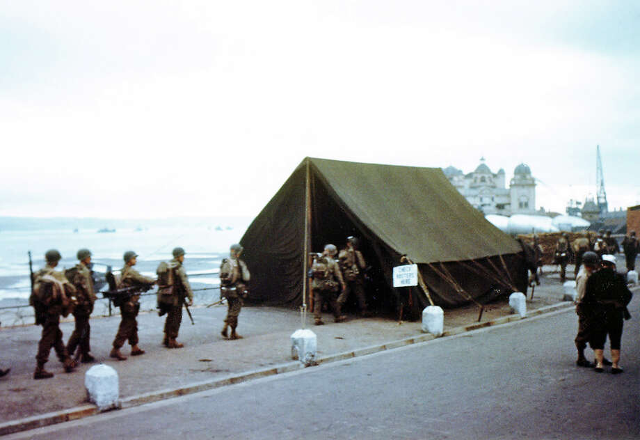 "Operation Overlord Normandy, Soldiers are checking their assignments in a tent near the port. June 1944. The sign at the entrance says: ""Check Rosters Here."" They will leave from here to participate in the invasion of Normandy, France. Weymouth, United Kingdom. Photo: Galerie Bilderwelt, Getty Images / 2010 Galerie Bilderwelt"