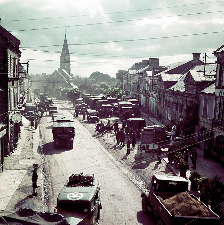 Operation Overlord Normandy, United States Army trucks, jeeps and other vehicles have entered a town in Normandy, France. June 1944. They are part of the invasion troops fighting the German Army. France. Photo: Galerie Bilderwelt, Getty Images / 2010 Galerie Bilderwelt