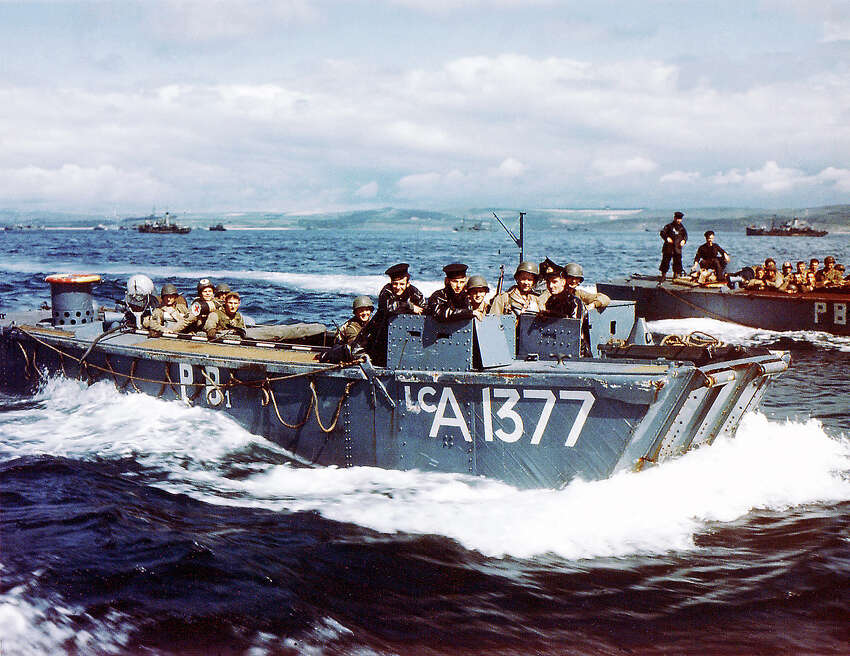 Operation Overlord Normandy, British Navy Landing Crafts (LCA-1377) carry United States Army Rangers to a ship in Southern England. 1st June 1944. There are British soldiers in the conning station. Rangers embark and remain consigned five days on board English ships for safety measure. The troops will participate in the invasion of Normandy, France. Weymouth, United Kingdom.