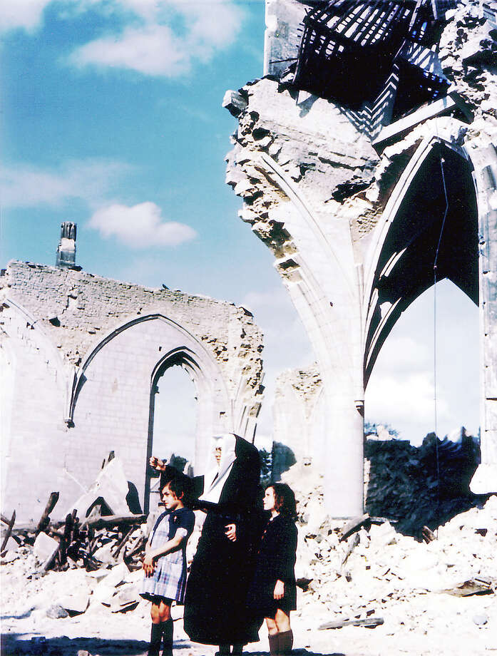 Operation Overlord Normandy, A catholic nun and two young girls are standing in front of the ruins of the bombed Eglise Saint-Malo in Valognes, Brittany. July 1944. The town was badly damaged during the Allied drive on Cherbourg in June. France. Photo: Galerie Bilderwelt, Getty Images / 2010 Galerie Bilderwelt