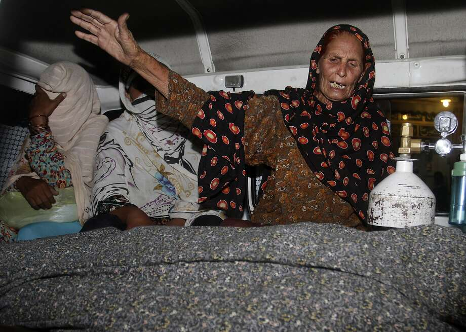 A family member of Farzana Parveen, 25, wails over her body at a hospital in the city of Lahore. Photo: K.M. Chaudary, Associated Press