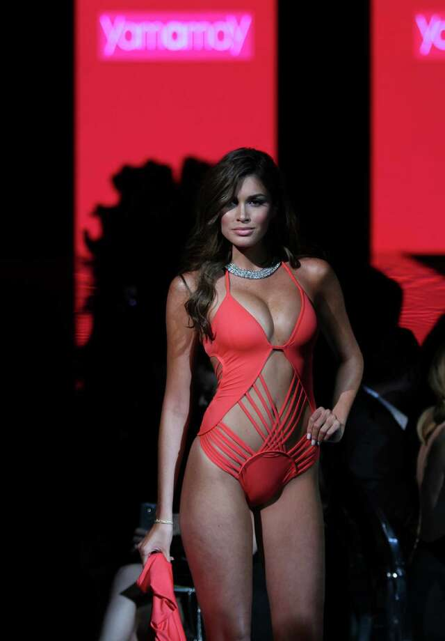 This model at Miami Fashion shows what can happen if you have a design for a one piece but not enough fabric. Photo: Sean Drakes/CON, Getty / 2014 Sean Drakes