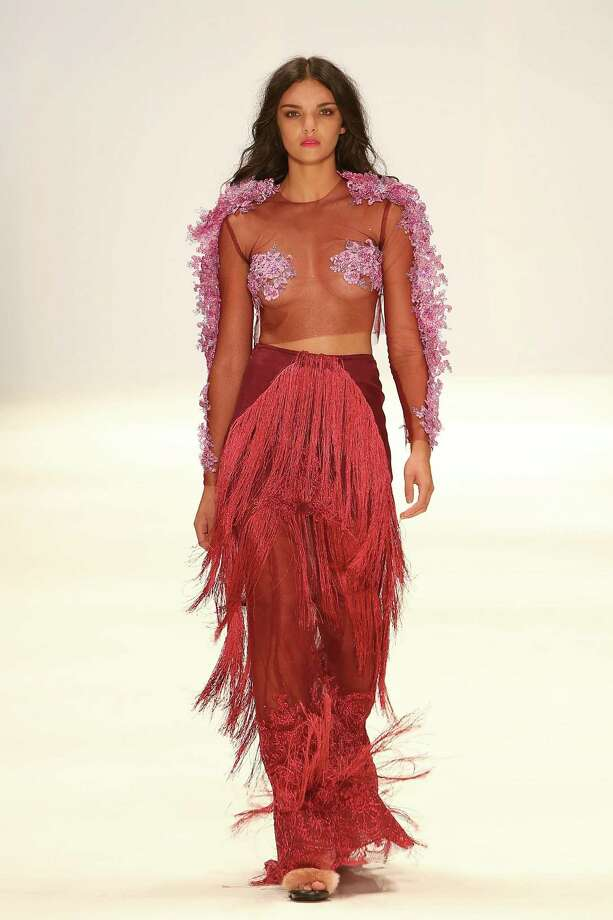 """One up the little mermaid by redefining the """"mermaid look."""" Why do the classic seashell bra and green tail when you can add all the fringe, flowers, and sheer fabric you want like this model at Mercedes-Benz Fashion Week. Photo: Matt Jelonek, Getty / 2014 Matt Jelonek"""