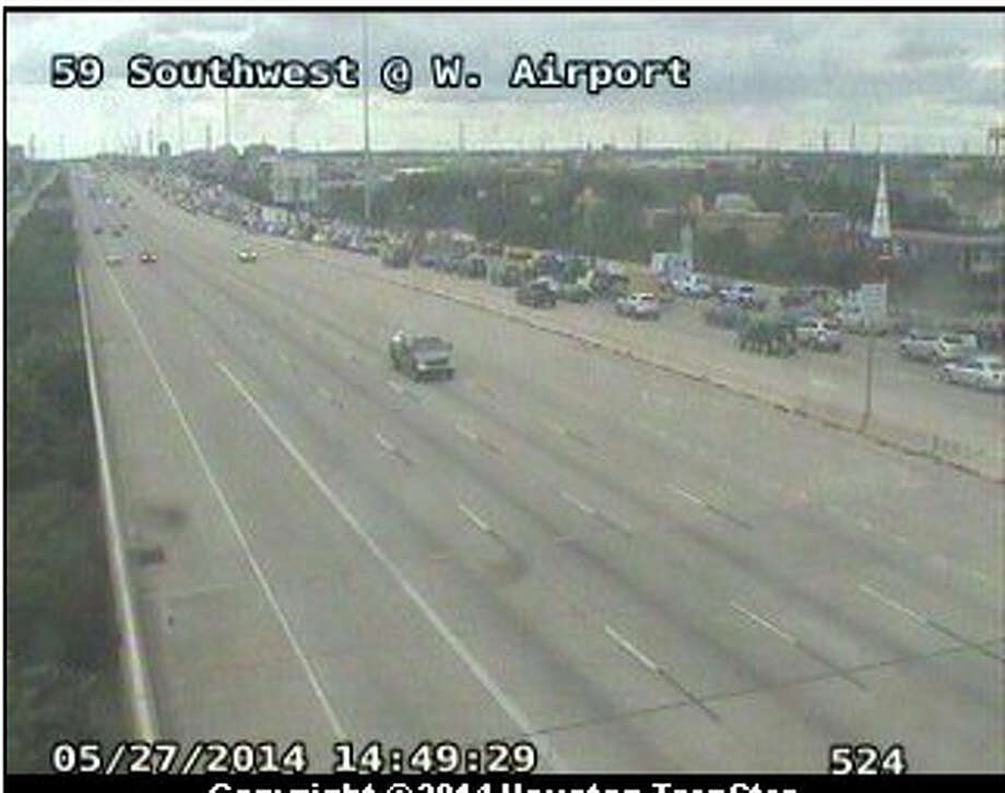 A LifeFlight helicopter that landed on the southbound Southwest Freeway at U.S. 90A has left for an area hospital, according to Houston TranStar. Photo: Transtar