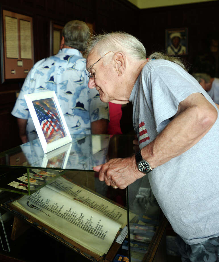 Gerald Fontenot looks at medals inside a display case at the Temple to the Brave on Monday afternoon. The Temple to the Brave in Pipkin Patriots Park opened its doors to visitors on Monday in honor of Memorial Day. The temple was originally erected in memory of service men and women who perished in World War I, but has expanded to memorialize veterans from every conflict since. Photo taken Monday 5/26/14 Jake Daniels/@JakeD_in_SETX Photo: Jake Daniels / ©2014 The Beaumont Enterprise/Jake Daniels