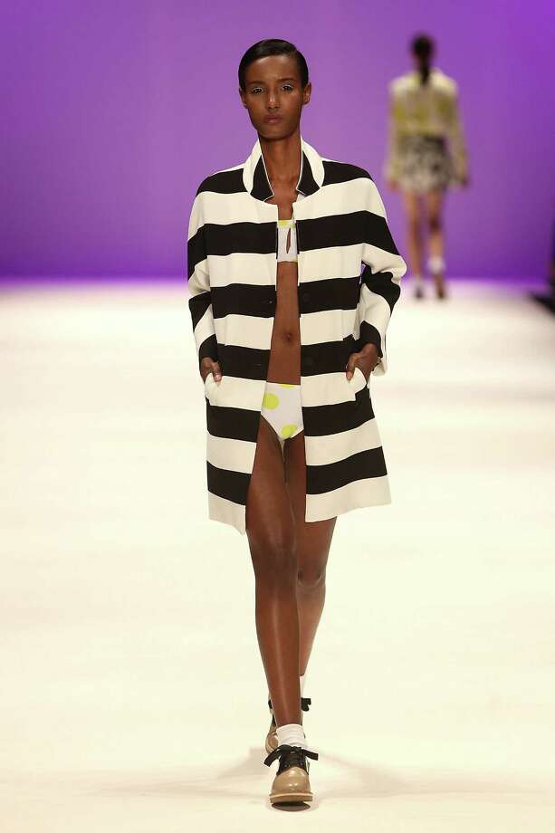 Nothing says beach like a bikini, coat, socks and closed-toed shoes as shown by this model at Mercedes-Benz Fashion Week. Photo: Graham Denholm, Getty / 2014 Getty Images