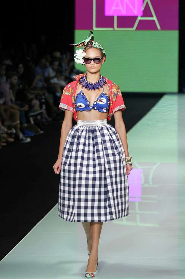 Practicality is best when it comes to packing for a vacation. Save some space in your luggage and just wear the picnic essentials. Like this model shows at Miami Fashion Week, it is not only practical, but the cloth napkins and blanket make for cute beachwear.  Photo: Sean Drakes/CON, Getty / 2014 Sean Drakes