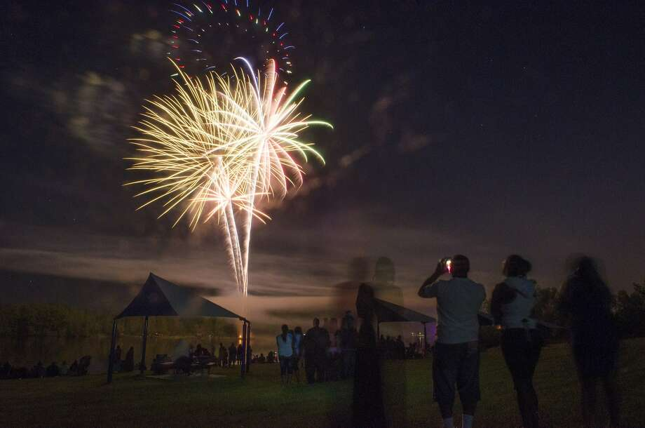 Summer begins with a bang: Fireworks light the sky during a summer kickoff celebration at Bluebell Beach in Genesee Township, Mich. Photo: Samuel Wilson, Associated Press
