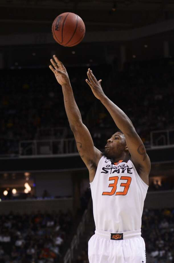 7. Los Angeles Lakers – Marcus Smart, 6-5, G, Oklahoma StateOklahoma State's Smart might not fit well next to Kobe Bryant, but he can be the Lakers point guard of the future and too good to let slide any further. Photo: Thearon W. Henderson, Getty Images