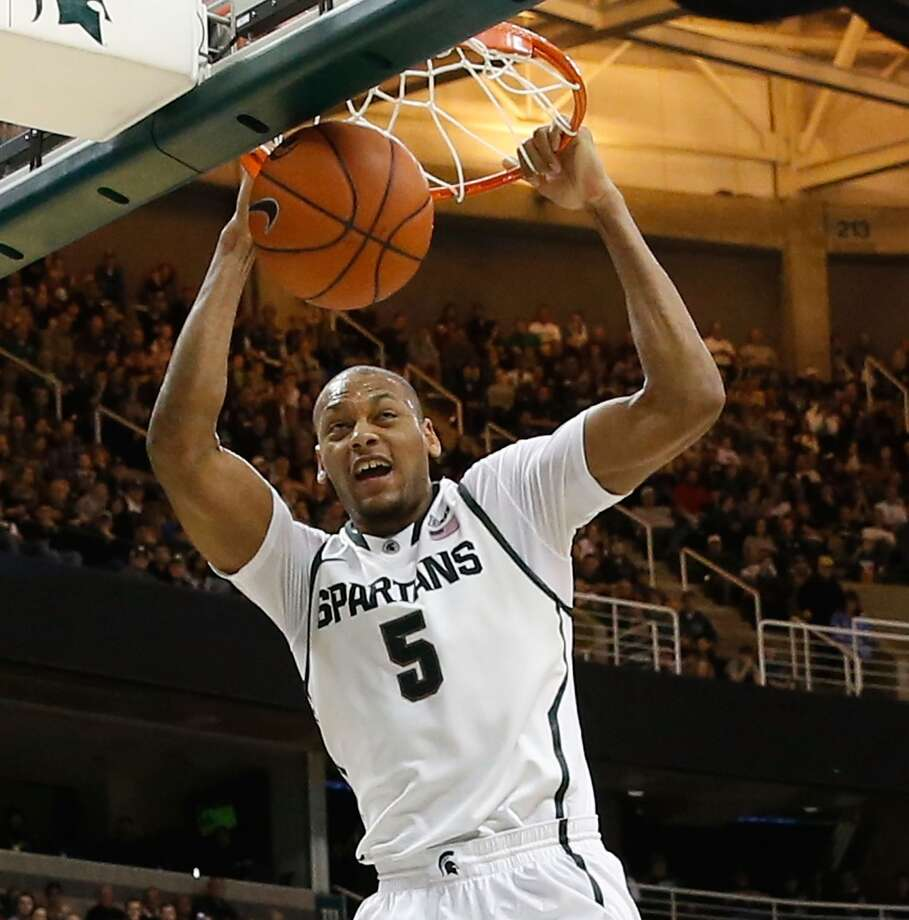 12. Orlando – Adreian Payne, 6-10, F, Michigan State  Though Payne would be a rare senior in the lottery, his predraft workouts could be key to working his way up the board since his shooting from the college 3-point line indicated potential to be a stretch four. Photo: Leon Halip, Getty Images