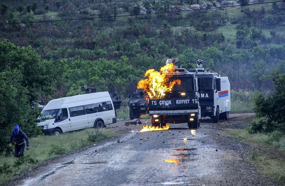 My work here is done:A Kurdish militant runs away after throwing a Molotov cocktail onto the windshield of a riot police vehicle at   Lice in Diyarbakir, Turkey. The Kurds were protesting the construction of a new gendarmerie outpost in Kurdish-dominated southeastern Turkey. Photo: Ilyas Akengin, AFP/Getty Images