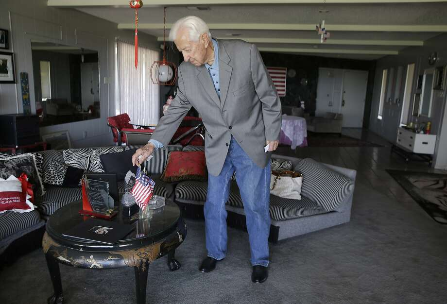 Rep. Ralph Hall, R-Texas, adjusts mini flags on a coffee table at his home in Rockwall, Texas. He first ran for political office in 1950 and won his seat when Jimmy Carter was president. Photo: LM Otero, Associated Press