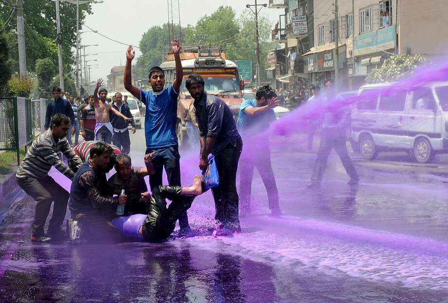 Will this come out in the wash?In Srinagar, Kashmiri government employees demanding pay increases and job   reforms are hosed down with purple-dyed water sprayed from a riot police water cannon. Photo: Rouf Bhat, AFP/Getty Images