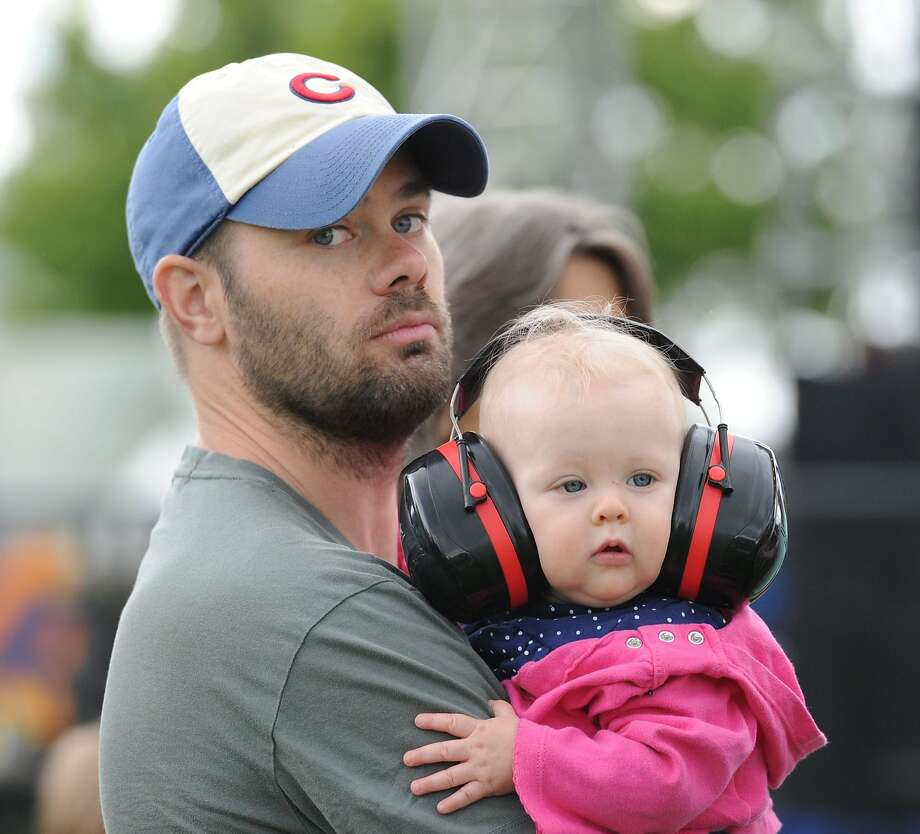Maybe when you're older: Peter Vallely doesn't want his 9-month-old daughter, Summer, exposed to the music of the indy band Dr. Dog during the 