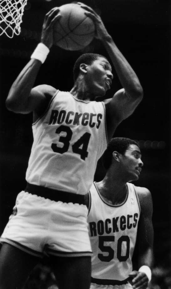 Hakeem teamed with Ralph Sampson, right, to form the Twin Towers. In 1986, the duo led the Rockets to NBA Finals, where they lost to the Boston Celtics in six games. Photo: Chronicle File