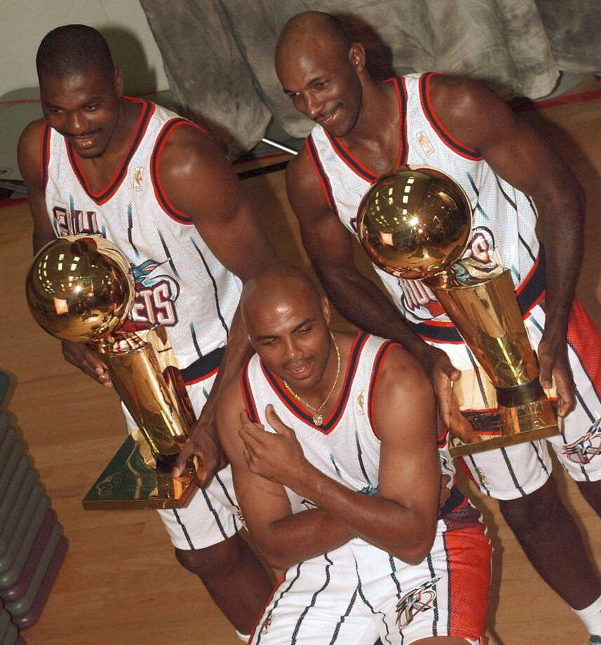 Hakeem and Clyde Drexler chased more NBA championships with Charles Barkley when he was acquired via trade. However, they were unable to get Chuck a ring. Photo: David J. Phillip, Associated Press
