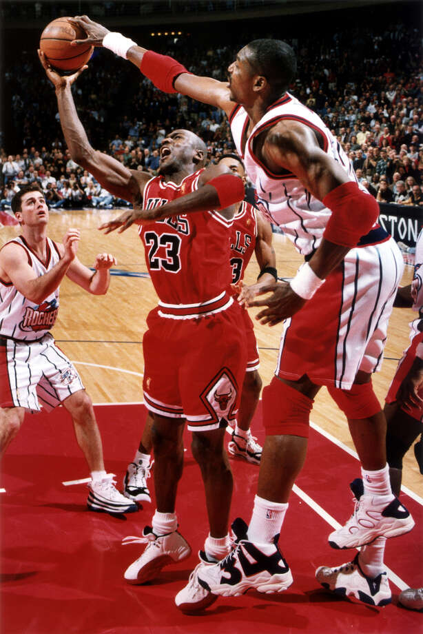 Hakeem and the Rockets often got the best of Michael Jordan and the Bulls in regular-season action. Photo: Smiley N. Pool, Chronicle