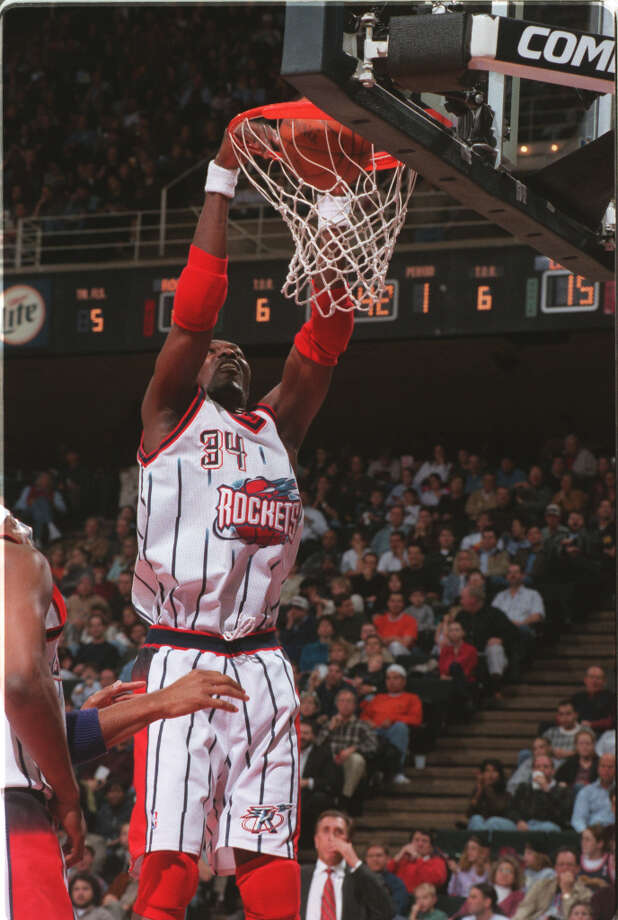 Known for his sweet touch, Hakeem could also rock the rim when needed. Photo: Steve Campbell, Chronicle