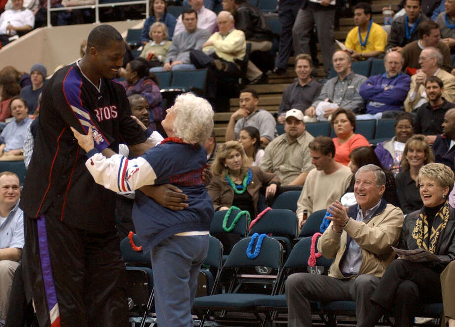 Patsy Demarest gives Hakeem a hug prior to his first game in Houston as a member of the Toronto Raptors in March of 2002. Photo: Karen Warren, Chronicle