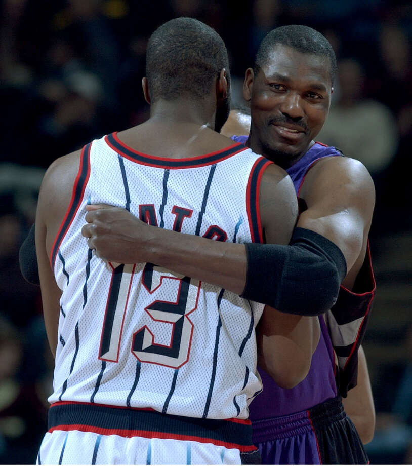 Hakeem hugs Kelvin Cato before the start of the game. Hakeem finished the night with seven points and seven rebounds in 25 minutes of action. Photo: Chronicle File