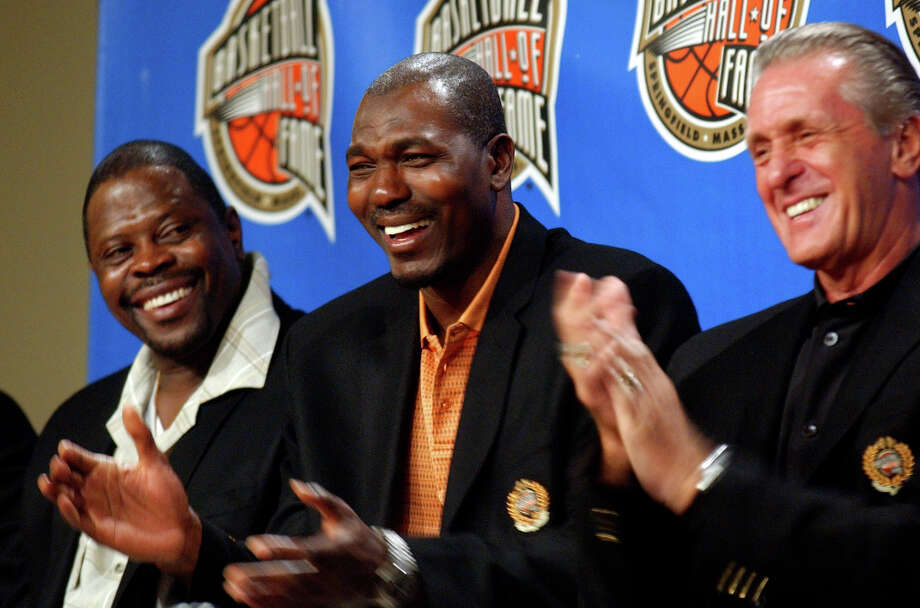 Along with Patrick Ewing, left, and Pat Riley, right, Hakeem was inducted into the Basketball Hall of Fame in 2008. Photo: Nathan K. Martin, Associated Press File