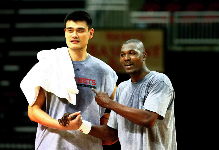 Yao Ming and Hakeem spent some time working out on the Toyota Center floor. Photo: Steve Ueckert, Chronicle / Houston Chronicle