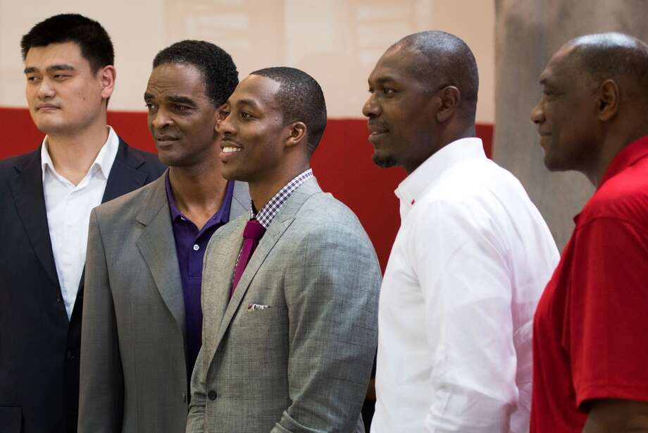 Dwight Howard, center, poses for a group photo with, from left, Yao Ming, Ralph Sampson, Hakeem and Elvin Hayes after Howard was introduced as the newest member of the Rockets legacy of great centers on July 13, 2013. Photo: Smiley N. Pool , Houston Chronicle